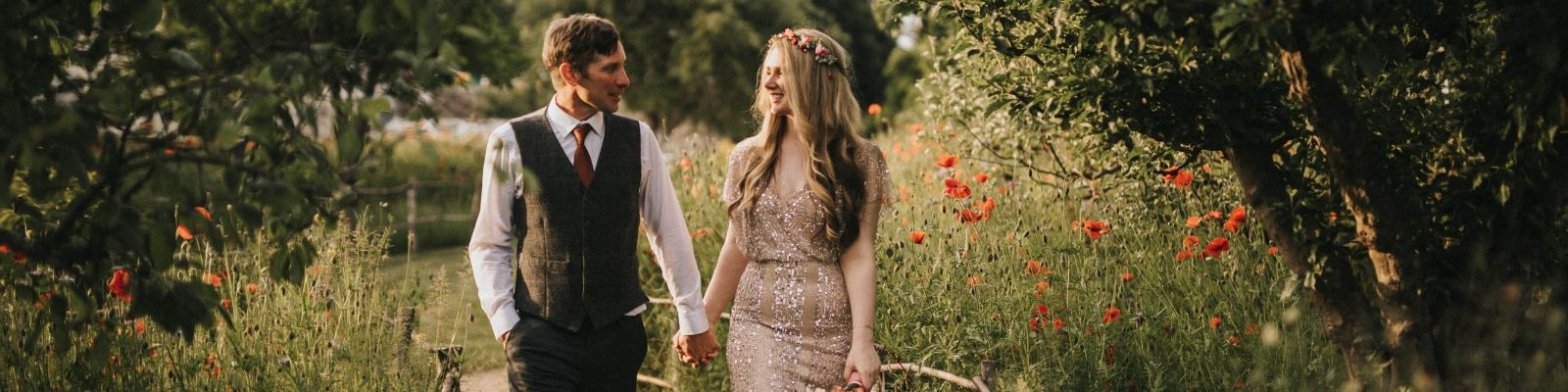 https://www.airfield.ie/wp-content/uploads/2019/05/Bride-and-Groom-in-the-wildflower-meadow-at-Airfield-Estate-min.jpg
