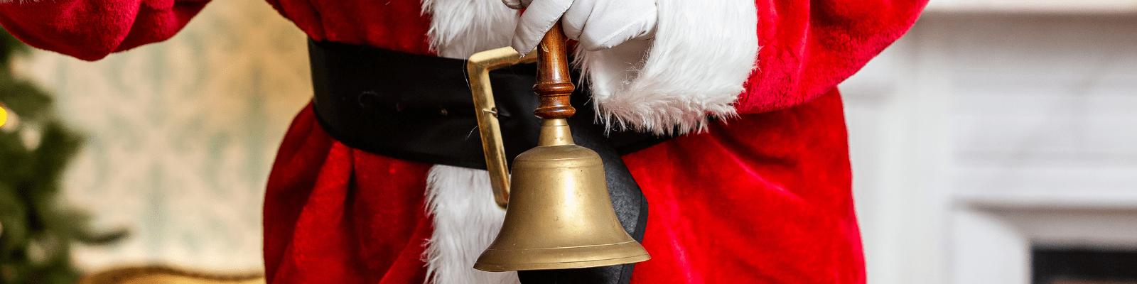 https://www.airfield.ie/wp-content/uploads/2020/09/Santa-Ringing-Bell-at-Airfield-Estate-min.png