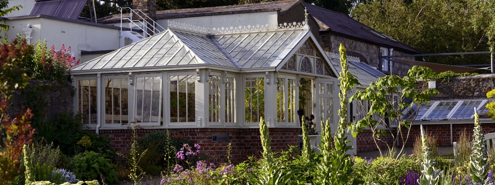 https://www.airfield.ie/wp-content/uploads/2021/08/Glasshouse-at-Airfield-Estate-1.jpg